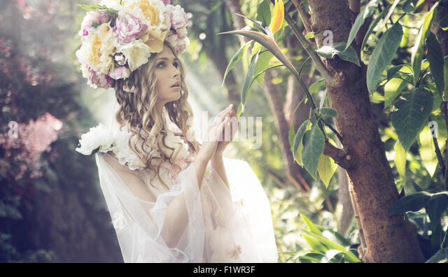 Portrait of the young blonde in the colorful jungle - Stock-Bilder