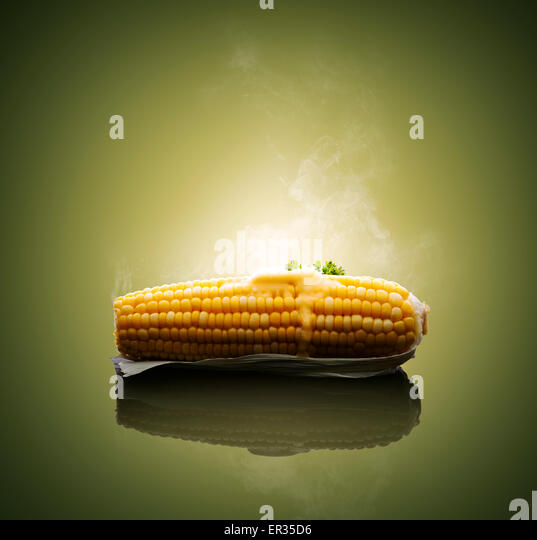 Cooked Ear of Corn with melting hot butter and steam - Stock Image