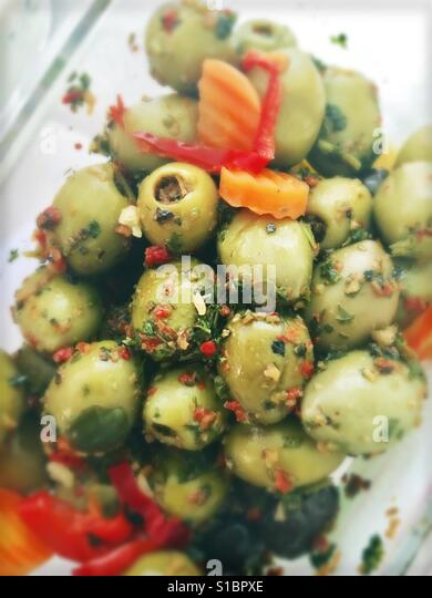 Stuffed green olives' - Stock Image