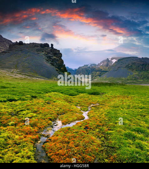 Typical Icelandic landscape with majestic canyon and pure water spring. Dramatic summer sunset in the Iceland, Europe. - Stock Image