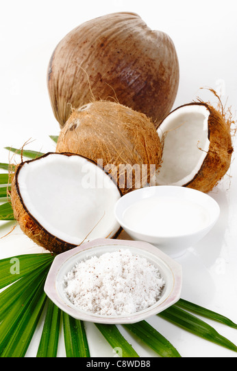 coconut, shredded coconut, and coconut cream on white - Stock Image