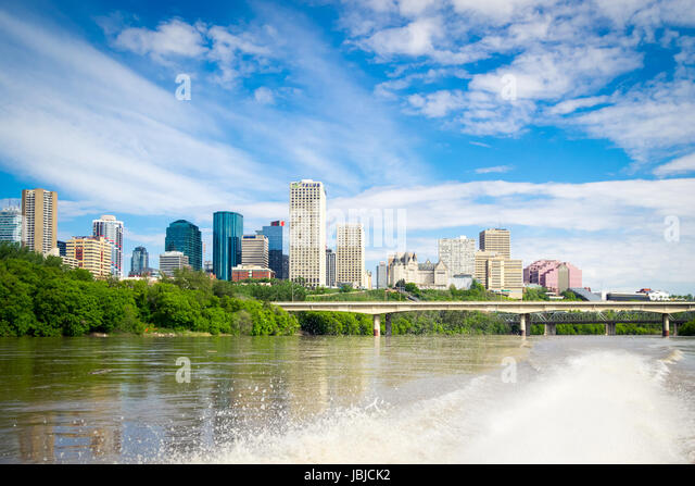The summer skyline of the city of Edmonton, Alberta, Canada, as seen from a speedboat in the middle of the North - Stock Image