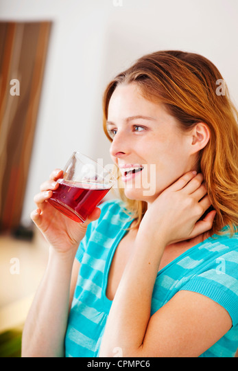 WOMAN WITH COLD DRINK - Stock-Bilder