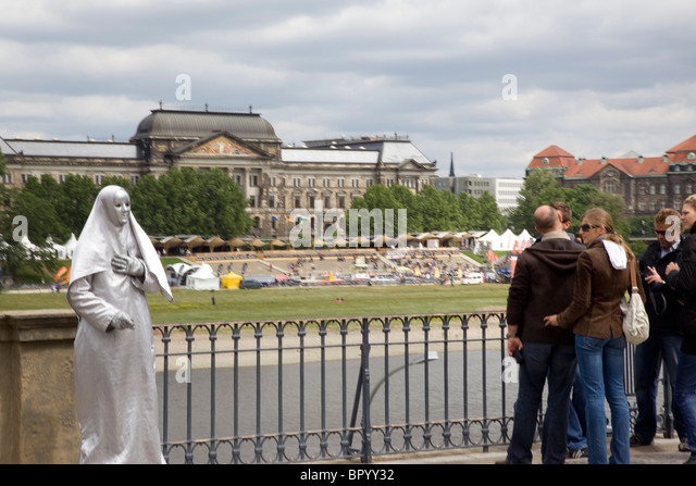 Photograph of a street actor in Dresden Germany - Stock Image