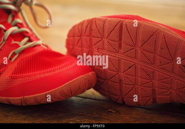 Pink ladies Nike trainer exercise shoes on wooden floor boards - Stock-Bilder
