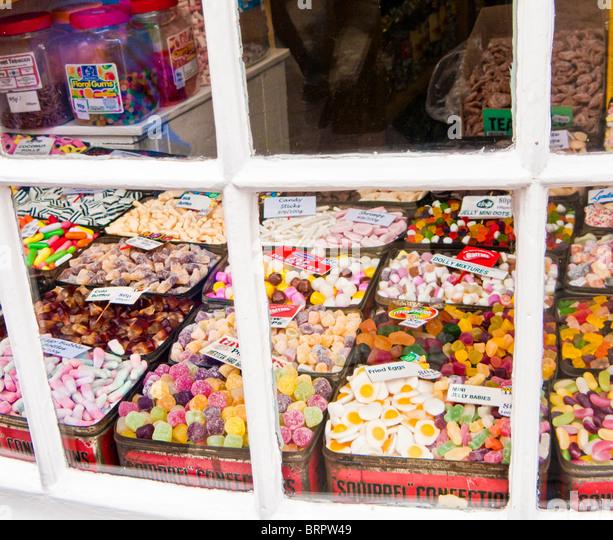 Old fashioned British sweet shop window display England UK - Stock Image