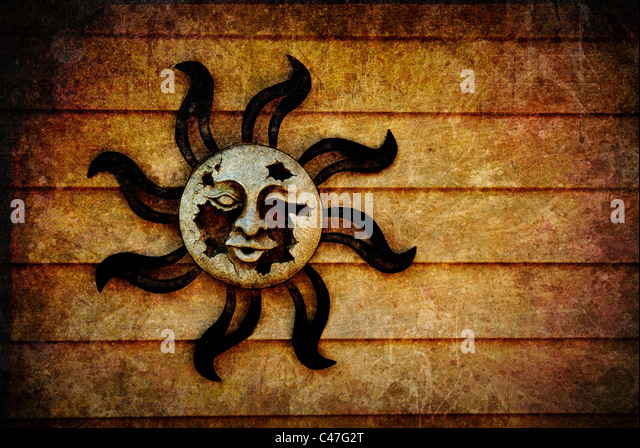 A broken, decaying pagan sun symbol with artistic, grunge style texture added and room for your text or images. - Stock Image