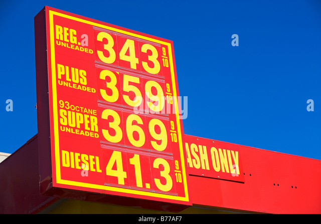 Gasoline prices advertised on gas station sign - Stock Image