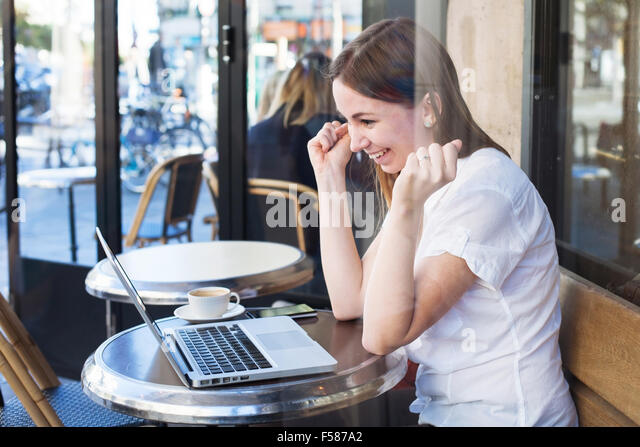good news concept, winner, happy lucky girl in front of computer - Stock Image