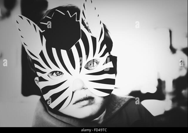 Portrait Of Boy Wearing Animal Mask At Home - Stock-Bilder