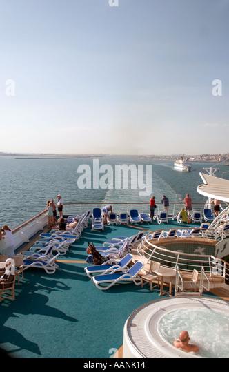 Passengers on a Cruise Ship leaving Cagliari, Sardinia , Europe - Stock Image