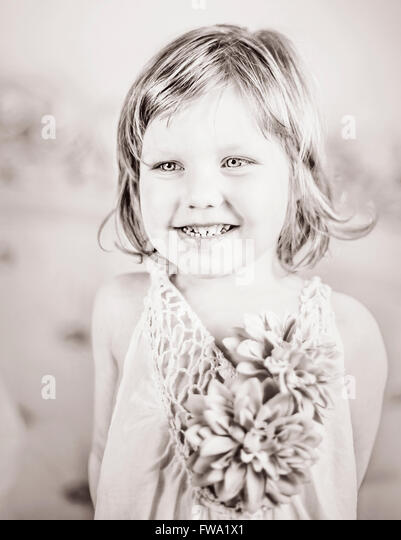 portrait of the pretty shy small girl - Stock Image