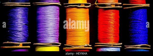 a colourful row of cotton reels - Stock Image