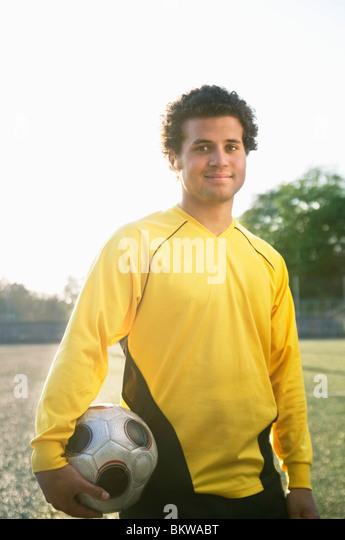 Football guy with football - Stock-Bilder