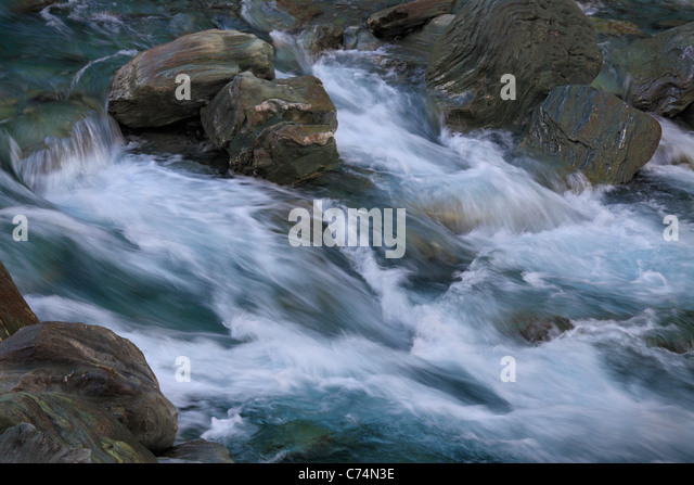 Detail of water flowing in the rocky Matukituki River between Wanaka and Mt Aspiring National Park - Stock Image