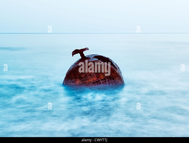 A metal wreck in the sea. - Stock Image