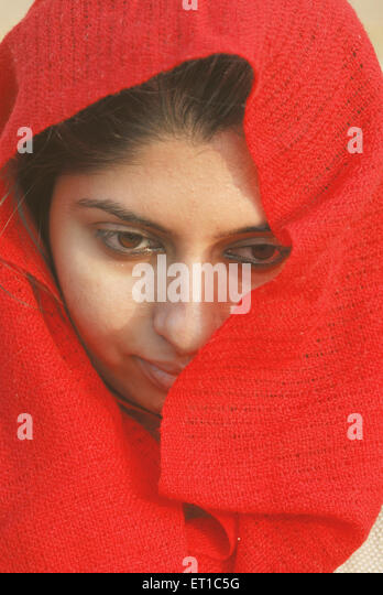Girl in red scarf ; Jaisalmer ; Rajasthan ; India MR#704 - Stock Image
