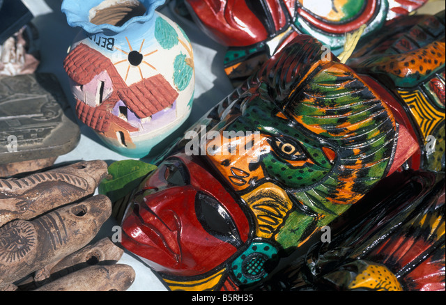 Belize colorful wood souvenirs with Maya faces shopping options in this western caribbean cruise port Central America - Stock Image