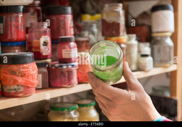 Close-up of artist's hand with colors and pigments, Bavaria, Germany - Stock Image