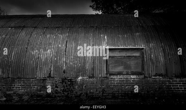 Delapidated, rusty and broken old shed - Stock-Bilder