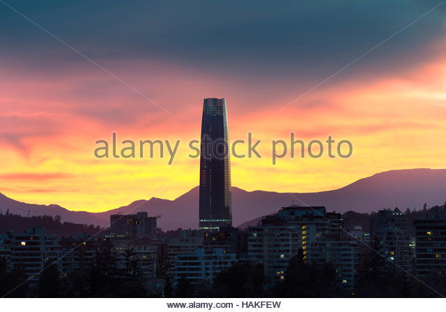 Costanera Center and skyline of apartment buildings at sunset in the wealthy district of Las Condes in Santiago - Stock Image