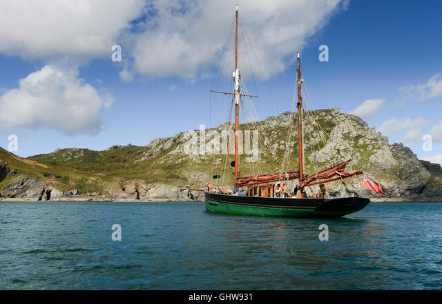 The Provident a former Brixham sailing trawler convert to carry passengers, off the Devon coast - Stock Image