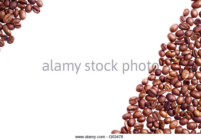 Brown roasted coffee beans isolated on white background - Stock Image
