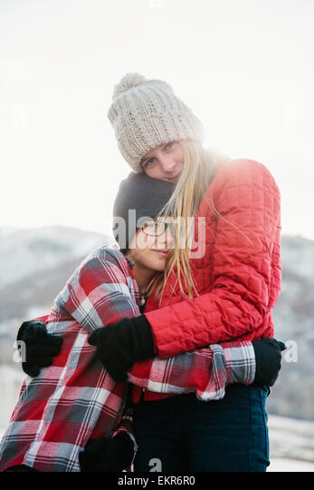 A brother and sister hugging each other. - Stock Image