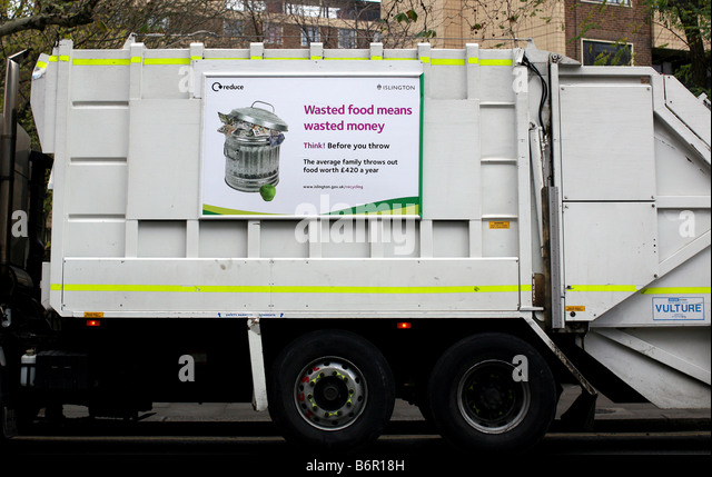 Food waste poster on dustcart in London - Stock Image