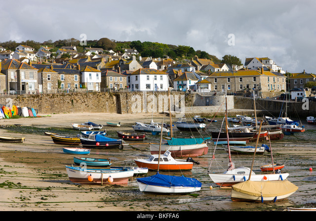 Views over Mousehole village and harbour at low tide, Mousehole, Cornwall, England. Autumn (October) 2009 - Stock Image
