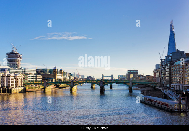 Southwark bridge over The Thames River and the city of London, England, UK - with the Shard - Stock Image