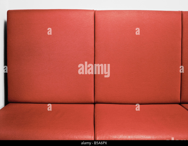 Red Leather Couch Close up - Stock Image