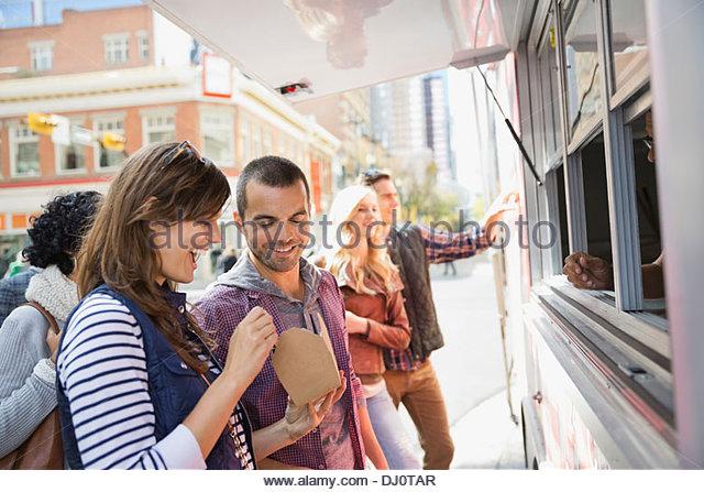 Couple enjoying take out food - Stock Image