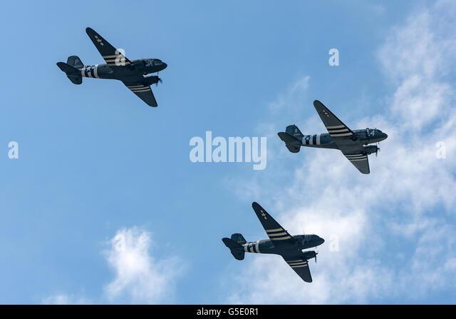 Three World War II era Douglas C-47 (DC-3) transport aircraft flying in formation at the Farnborough International - Stock Image