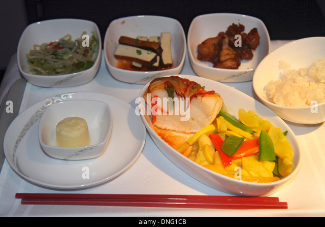 China Beijing Air China airlines onboard meal food fish squash rice chopsticks service vegetables tofu - Stock Image
