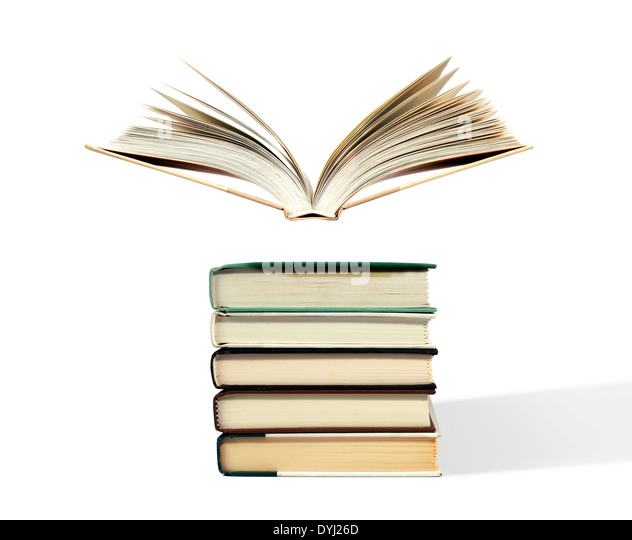 Studio shot of an Open book floating above stack - Stock Image