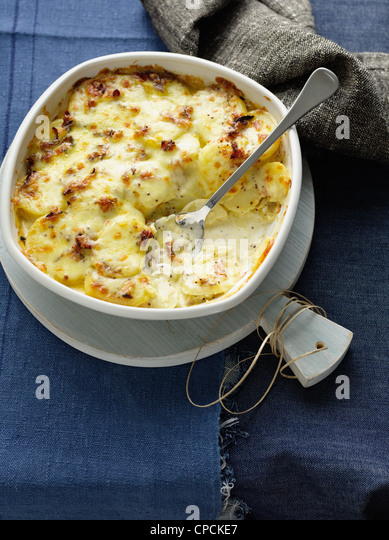 Sliced potato casserole with cheese - Stock Image
