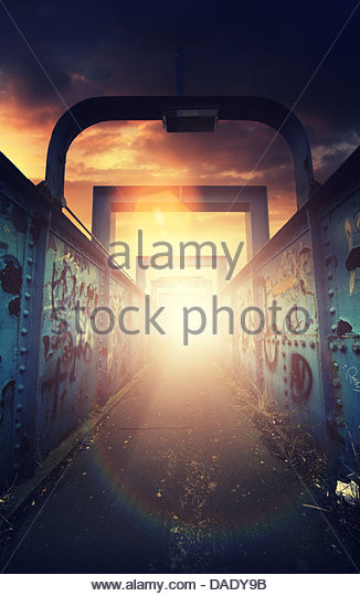 sunlight foot bridge - Stock Image