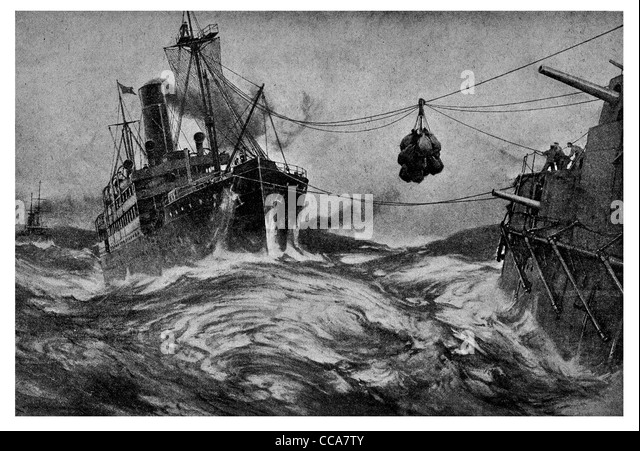 1916 Warship being loading coaled during gale storm refueled fuel coal high seas crashing waves merchant supply - Stock Image
