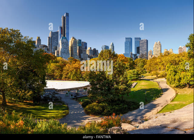 Fall in Central Park: Wollman Rink and Manhattan skyscrapers. Cityscape autumn view of Central Park South, New York - Stock Image