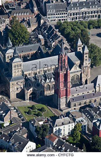 The Netherlands, Maastricht, Church called St Servatius Basilica, Church right with red tower called St Jans. Aerial. - Stock Image