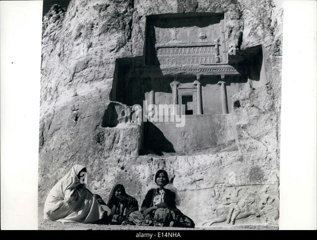Apr. 18, 2012 - It could be history as these local peasants relax beneath the carvings around the tomb of an ancient - Stock Image