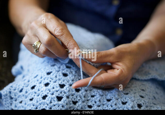 Close up picture of a Caucasian woman crocheting at home - Stock-Bilder