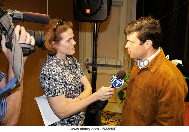 Miami Florida InterContinental Hotel Mayors' Hemispheric Forum press conference Hispanic woman TV reporter interview - Stock Image