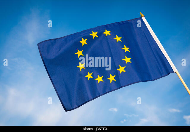 EU European Union flag flying outdoors in bright blue sky - Stock Image