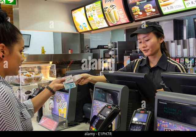 Brisbane Australia Queensland Fortitude Valley Chinatown McDonald's fast food restaurant Asian woman employee - Stock Image