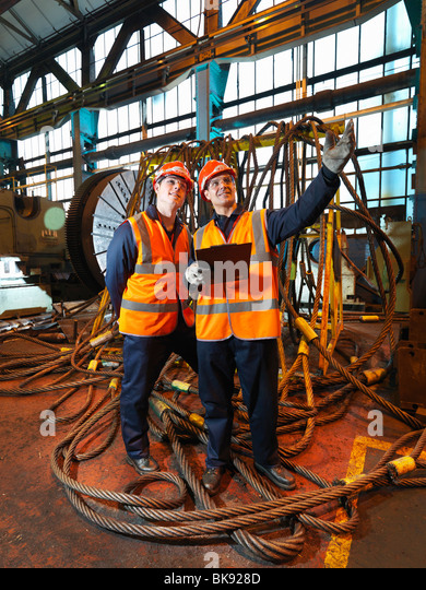 Steel Workers With Clipboard and Ropes - Stock-Bilder