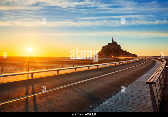 Road to Mont Saint Michel at sunset, Normandy. France. - Stock Image