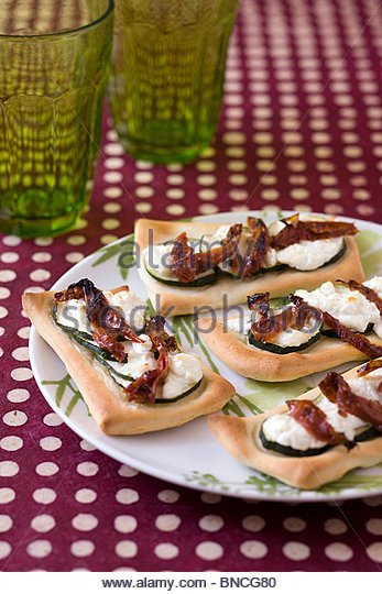 Goat cheese courgette pizzettes - Stock Image