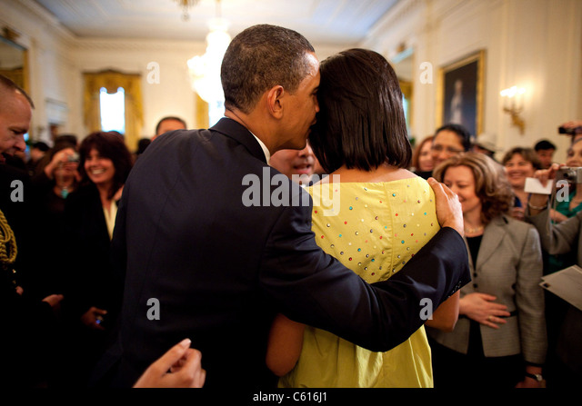 President Obama whispers into Michelle's ear during the White House Cinco de Mayo celebration. Michelle wears - Stock Image